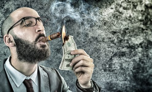 wasting money, burning money, Facebook page likes, Facebook fans