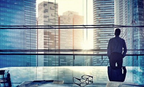 build a business website using Wordpress, businessman looking out city window